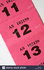 strip of pink raffle tickets on white background stock photo stock photo strip of pink raffle tickets on white background