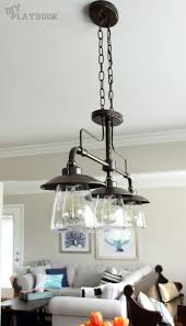 kitchen room pull table: trio of industrial lights from lowes over this wooden dining room table