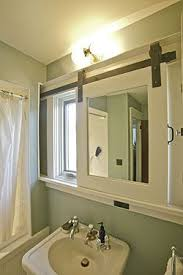 sliding bathroom mirror: bathroom space always comes at a premium so during the renovation of our upstairs bathroom i designed a sliding privacy door for the toilet alcove