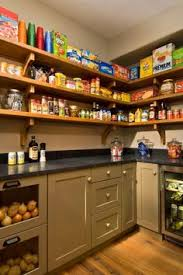 walk in pantry love this idea perfect reuse of the old laundry room connected to the kitchen note the glass doors in the onion bins fantasy pantry