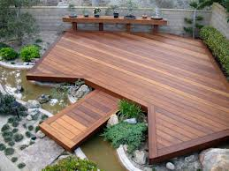 deck lighting ideas waplag asian inspired garden with ipe decks and built in small river plus hedge shrubs asian inspired lighting