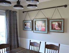 dining room wall decorating ideas: iron pipe family photo display dining room ideas home decor repurposing upcycling wall decorcute idk bout the hardware thoughbranch not big of frame