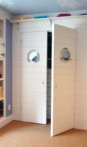 Porthole Mirrors On A Closet For Nautical Kids Room