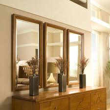 Inside Living Room Design Decorations Rectangular Mirrors On Beige Wall Above Rusic Wooden