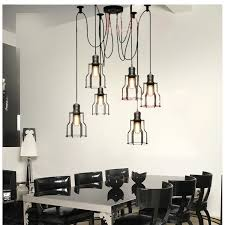dining room lighting idea with low ceiling industrial cage pendant lights over glass top rectangular ceiling industrial lighting fixtures industrial lighting