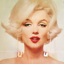 Thought my new Amy Glenn safety pin earrings looked pretty good on Marilyn Monroe. Sorry, Bert Stern. P.S. Amy makes some cool T-shirts too. - marilyn