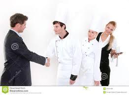 handshake restaurant manager and kitchen staff stock photos handshake restaurant manager and kitchen staff