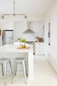 naremburn inspiration for a farmhouse galley kitchen remodel in sydney with white cabinets white backsplash subway industrial kitchen lighting awesome vintage industrial lighting fixtures remodel