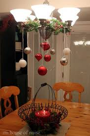 cheap christmas decor: decorating chandelier above the dining table  creative diy christmas decorations you can make