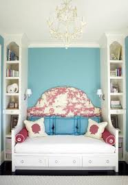 girls rooms turquoise blue accent wall white chandelier red toile upholstered fabric headboard built chandelier girls room