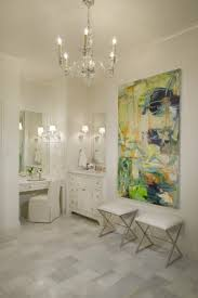 master bathroom with visual comfort lighting george ii chandelier and abstract canvas art over modern polished nickel x base bathroom ottomans bathroom chandelier lighting