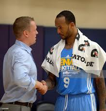 the denver nuggets pre draft workouts pictures getty images travis releford kansas shakes hands the nuggets new general manager tim connelly during