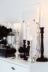 i chose this image because the lighting of the candles creates an ambient glow agaisnt the white walls also the blance of the white black and silver of amazing white black bedroom
