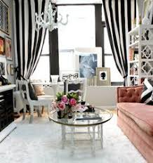 black and white stripes in a beautiful feminine office with pink tufted seating beautiful white home office