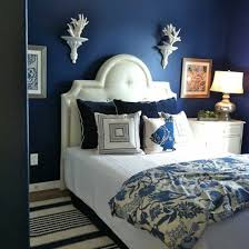 bedroom navy blue wall interior for small bedroom space with chic white bed sets plus pleasant black and white stripes carpet and interesting wall picture chic small bedroom ideas