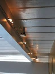 lighting for basements. basement with lighting track ceilings exposed beams basements for