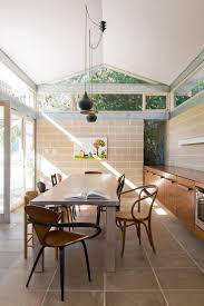 room modern camille glass: this mid century cottage by cracknell amp lonergan with through a transformation that added much needed