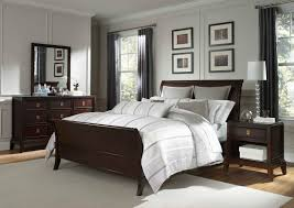awesome brown wooden bed by broyhill furniture with silver bedding on white tile floor which matched with white wall with gray curtains for bedroom decor awesome white brown wood