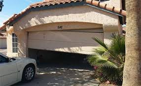Image result for carashed garage door