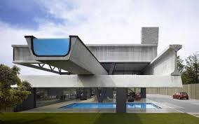 INSPIRING MODERN HOUSE DESIGNS INSPIRING MODERN HOUSE DESIGNS  exterior view of a house made of concrete and pool