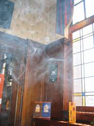 should smoking be banned from public places what are the effects english this photo illustrates smoke in a pub a common complaint for those concerned