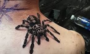 Tat's realistic! Incredible tarantula <b>tattoo</b> looks like a real <b>spider</b> ...