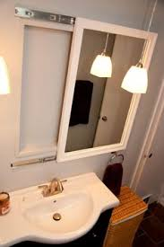 sliding bathroom mirror: mirror on drawer tracks for hidden medicine cabinet