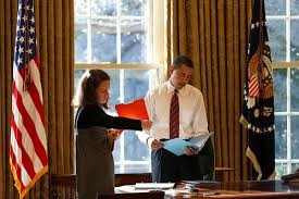 president barack obama looks at daily correspondence in the oval office with his personal secretary katie johnson 13009 source official white house barack obama oval office