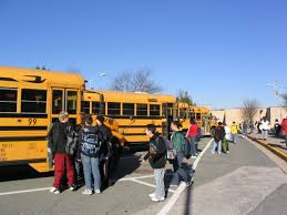 opinion let s try some year round schools com students wait to board school buses