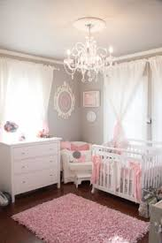 despite our tiny room and budget i was determined to give our baby the room chandelier girls room