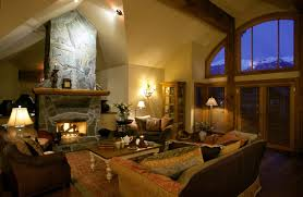 spacious living room with large stone fireplace with wood mantle beautiful living rooms living room