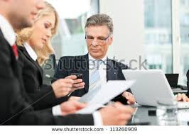 business people team meeting in an office the boss is checking his mails business nap office relieve