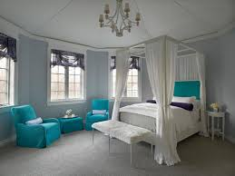 lovable dream bedroom design for teenage girl with blue fabric upholstered armchair near window and white bed girls teenage bedroom