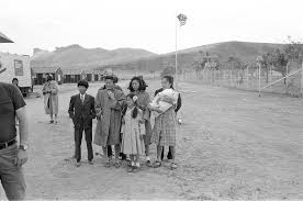 filming farewell to manzanar at tule lake seeing one camp in in the family group scene l to r vernon kato calvin nobu mccarthy misa dori takeshita young jeanne momo yashima alice akemi kikumura chiyoko