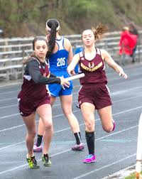 raiders power through relay event news sports jobs m news south range s ashley mckee hands off to rose pallota in the distance medley during the fourth