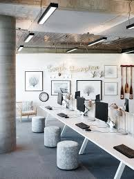 i think that the blue and gray tones in this office area where a very good idea because they help to stimulate creativity and also calmness brave business office decorating ideas awesome