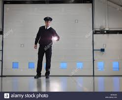 security guard torch in warehouse stock photo royalty security guard torch in warehouse