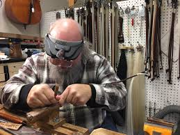 in issaquah beautiful music comes from wood patience and veteran luthier rick wickland works on part of a violin bow at his work bench inside hammond ashley violins in issaquah the horse hair used on the bow is