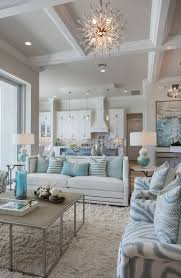 apart from the geometric design of the ceiling and keeping everything pristine white a nice and unique lighting will also work notice that the lighting is beach house lighting fixtures