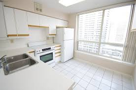 spacious eat in kitchen with brand new stove dishwasher with a newer fridge facing spacious eat kitchen