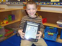 child holding iPad