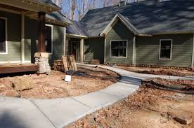 front sidewalks were poured this curves around from the front porch to the breezeway where the mud room door is to the house doors to the office and the breezeway garage office
