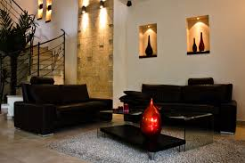 black furniture in living room with wall alcoves blacks furniture