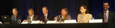 Image result for pictures of a panel of serious doctors sitting at a conference table