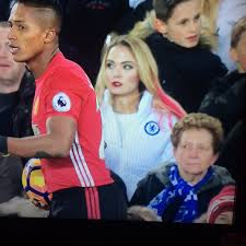 Image result for WOMAN WORE CHELSEA JACKET TO MAN U MATCH