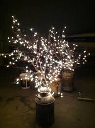 cheap wedding lighting use old milk cans branches and white lights cheap diy lighting