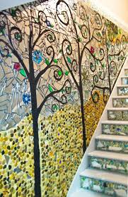 mosaic wall decor: i did a mirror and stone mosaic on the steps going to the basement