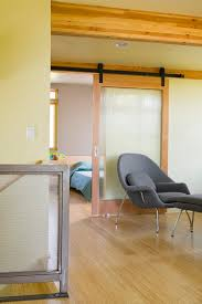 phinney ridge house inspiration for a modern hallway remodel in seattle with beige walls and light architects sliding door office