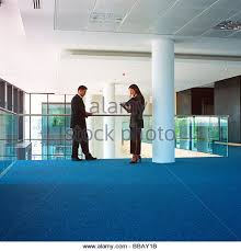 man and woman in discussion on the mezzanine floor in an office block stock image agri office mezzanine