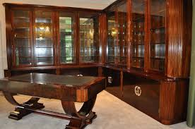 dark coloured art deco desk and bookcase via timeless interiors art deco office
